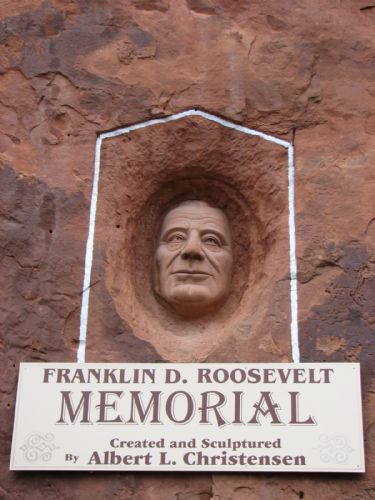 Franklin Roosevelt Memorial is carved into the front of the Hole N The Rock south of Moab